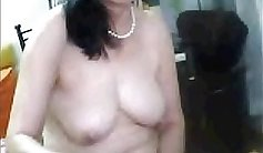 Lusty mature chinese fucks herself over and