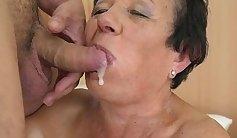 Granny nurses massive schlong and sprays cum in the car