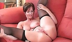 Busty British MILF Kate plays with her cunt at the back strapon