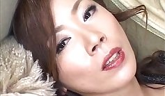 Attractive Japanese model Yuria Asa Akira grabs a vibrator and gets her titties