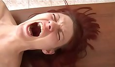 redhead that has slim tits is getting a big dick in her mouth